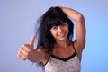 Young beauty beautiful woman lifts thumb upwards Stock Image