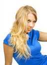 Young beauty blond girl in blue shirt Royalty Free Stock Photography