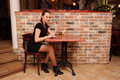 Young beauty girl in cafe Stock Photo