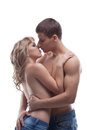 Young beauty man kiss sexy girl posing topless Stock Photography