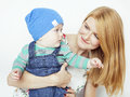 Young beauty mother with cute baby, red head happy modern family isolated on white background close up, lifestyle people Royalty Free Stock Photo