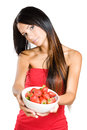 Young beauty offering strawberries. Royalty Free Stock Image