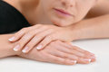 Young beauty with polished finger nails, relaxed Royalty Free Stock Photo