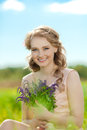Young beauty smiling woman in the field, on the grass. Girl rest Royalty Free Stock Photo
