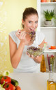 Young beauty woman eating sprouts Royalty Free Stock Photo