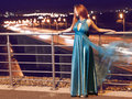Young beauty woman in fluttering blue dress outdoor Royalty Free Stock Photos