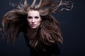 Young beauty woman with flying hair Stock Photo