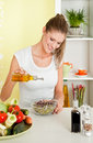 Young beauty woman making sprouts salad Stock Image