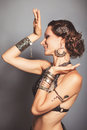 Young beautyful tribal dancer woman on gray Stock Images