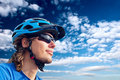 Young bicyclist in helmet and glasses Royalty Free Stock Photos