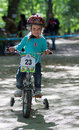 Young biker on child bicycle competition. Royalty Free Stock Photography