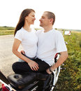 Young biker couple on the country road Royalty Free Stock Photo