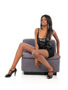 Young Black American Woman sitting on a couch Stock Image