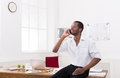 Young black businessman with mobile in modern white office Royalty Free Stock Photo