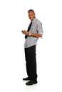 Young Black Businessman with smart phone Stock Photography