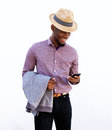 Young black guy using mobile phone Royalty Free Stock Photo