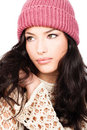 Young black hair girl in wool sweater and cap Royalty Free Stock Photo