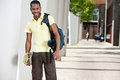 Young Black Male With Skateboard and Bag Royalty Free Stock Photo