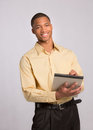 Young Black Male Writing on Notepad Royalty Free Stock Images