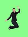 Young black man jumping on a green background Royalty Free Stock Photo
