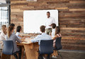 Young black man at whiteboard giving a business presentation Royalty Free Stock Photo