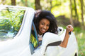 Young black teenage driver holding car keys driving her new car beautiful Royalty Free Stock Photography