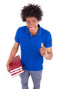 Young black teenage student men holding books african people man isolated on white background Stock Photo