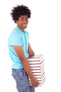 Young black teenage student men holding books african people man isolated on white background Stock Photos
