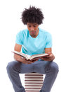 Young black teenage student men reading a books african people man isolated on white background Stock Image
