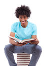 Young black teenage student men reading a books african people man isolated on white background Stock Photo