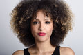 Young black woman with afro hairstyle on white background Royalty Free Stock Photo