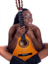 Young black woman implied nude behind guitar Royalty Free Stock Photo