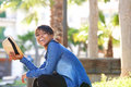 Young black woman laughing outside with hat profile portrait of a Stock Photography