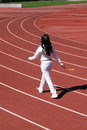 Young black woman walking sweat suit on track Stock Photos