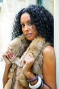 Young black woman wearing fur vest Royalty Free Stock Photo