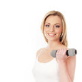 A young blond and fit woman holding a dumbbell Stock Photo