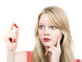 Young blond girl afraid with medicine pill beautiful over white background Stock Photo
