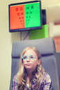 A young blond girl having an eye examination at an optometrist s clinic Royalty Free Stock Photos