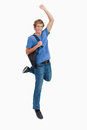 Young blond man jumping with a backpack Stock Photography