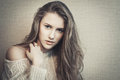 Young blond model looking at camera with questioning glance beautiful girl Stock Photos