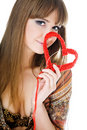 Young blond with a red knit heart Royalty Free Stock Photography