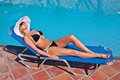 Young blond white woman on sunbed Stock Photos