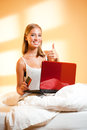 Young blond wiht laptop gorgeous woman using her in bed Stock Photo