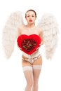 Young blond woman in angel costume holding heart this image has attached release Royalty Free Stock Photos