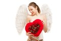 Young blond woman in angel costume holding heart this image has attached release Royalty Free Stock Images
