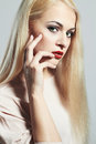 Young blond woman beautiful model with make up manicure red lips Stock Photo