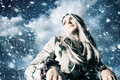 Young blond woman in a blizzard Stock Photos