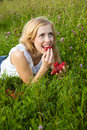 Young blond woman eating strawberries Royalty Free Stock Photo