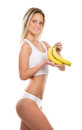 A young blond woman holding fresh bananas Stock Image
