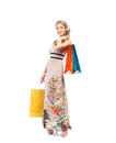 A young blond woman holding shopping bags and attractive caucasian in colorful dress the image is isolated on white background Stock Photo